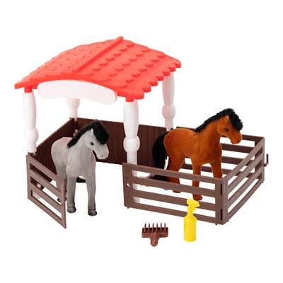 Stall mit Pferden oder Einhörnern